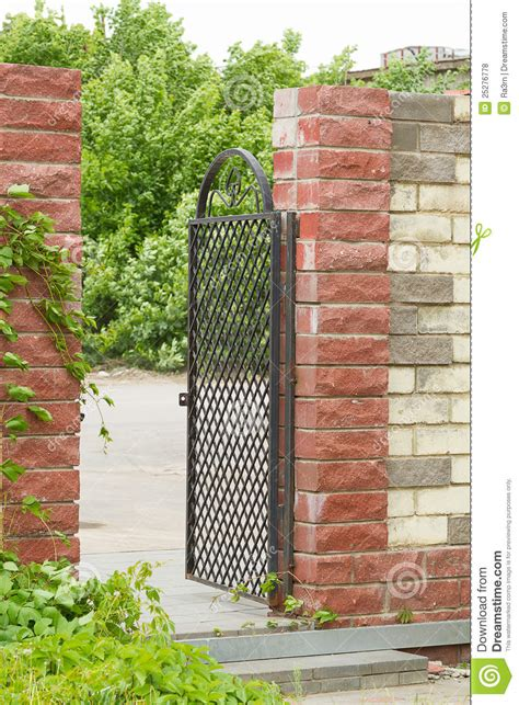metal gate in the brick wall stock photo image 25276778