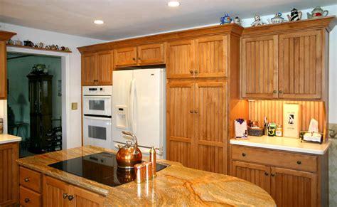 black beadboard kitchen cabinets honey oak kitchen cabinets kahles maple honey beadboard