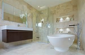 Glass shower stall in corner built in wall coves are internally lit