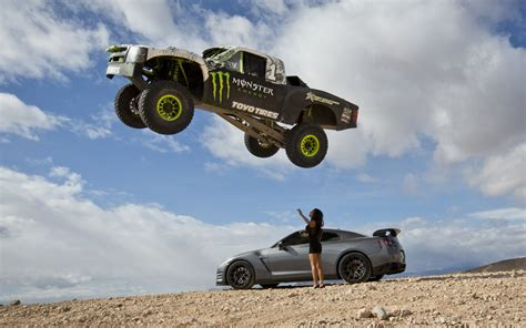 monster trucks videos video find godzilla and a trophy truck terrorize the desert