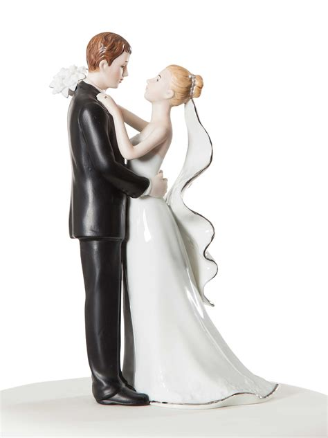 wedding cake topper with white and silver porcelain and groom wedding cake topper figurine