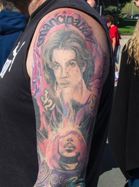 prince tattoo fans show their prince tattoos in of singer s