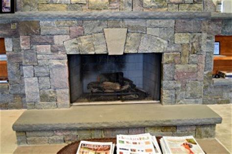 the cost of installing a stone veneer fireplace