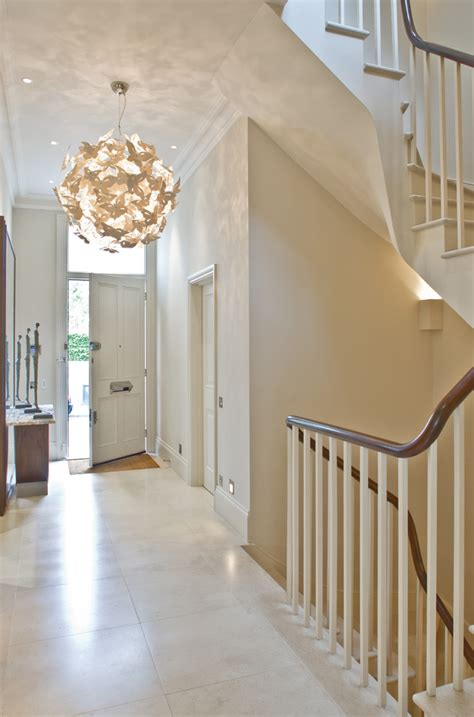 statement lighting statement lighting with white staircase entry traditional