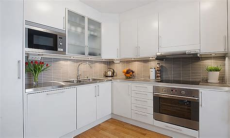 studio apartment appliances modern white kitchen cabinets
