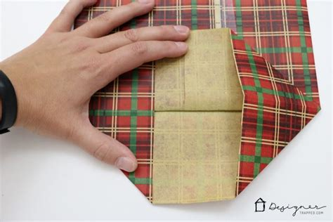How To Fold Wrapping Paper Into A Bag - how to make a diy gift bag for designer trapped
