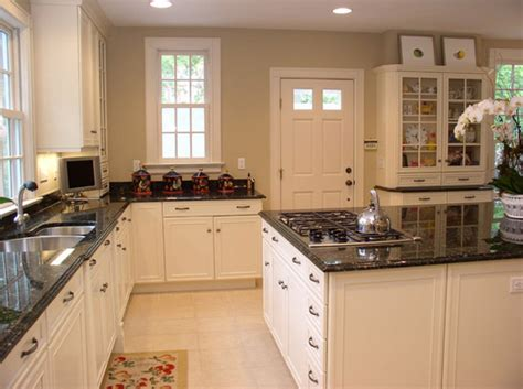 Kitchen Countertops With White Cabinets by White Kitchen Cabinets With Granite Countertop