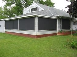fabric awnings and solar shades help homeowners beat the