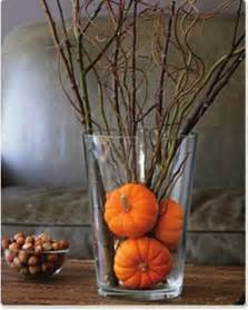 Simply put several very small pumpkins in a vase and add some twigs