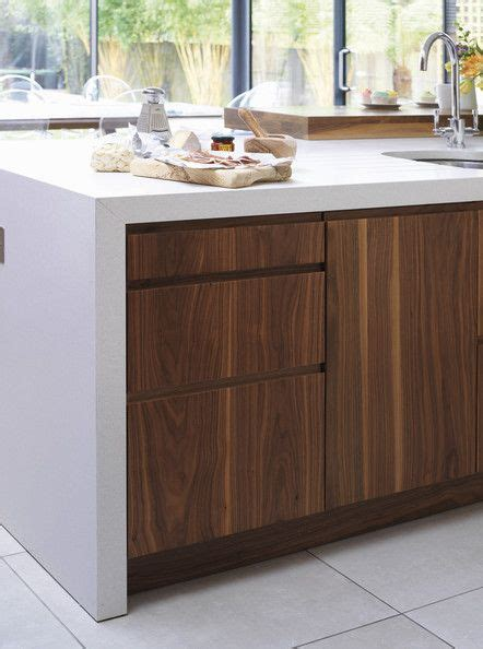 handle less walnut kitchen cabinets with wrap over stone