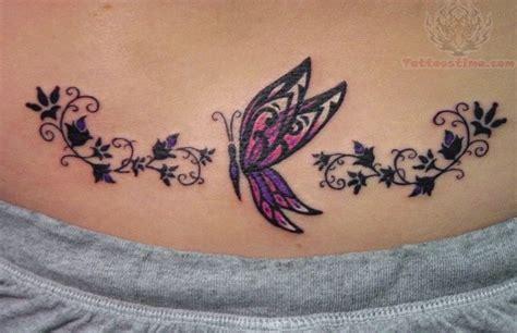 Awesome Colored Butterfly Tattoo On Lowerback Butterfly Tattoos On Lower Back