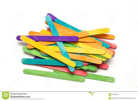 colored popsicle sticks pile of rainbow colored popsicle sticks stock photo