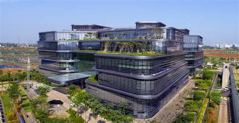 green roof design by spanish based firm on a architects village inspired office in jakarta is topped with living