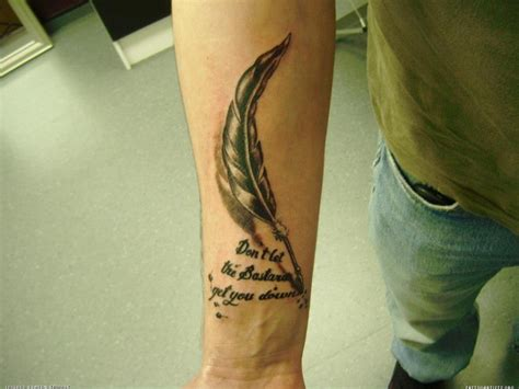 pen tattoo forearm feather pen and quote arm tattoo tattoomagz