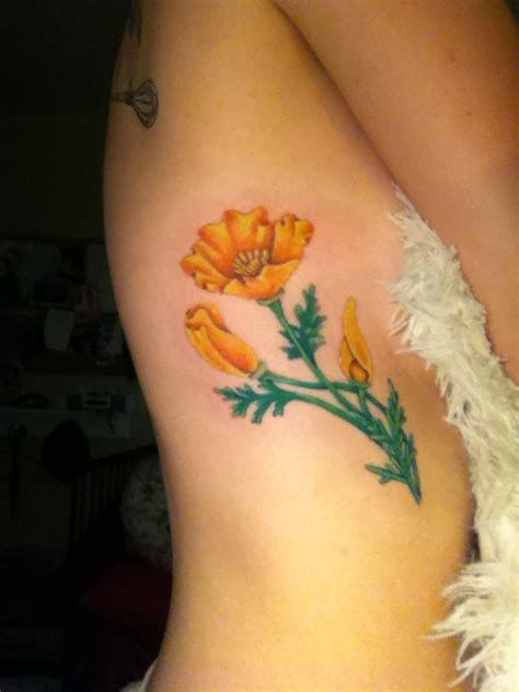 california poppy flower rib tattoo