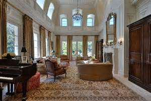 The two story living room is very formal but this kind of house asks