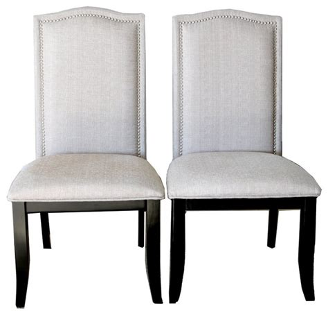 upholstered beige fabric dining chairs with nailhead trim