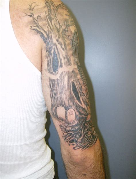 tree tattoo on arm graveyard tattoos