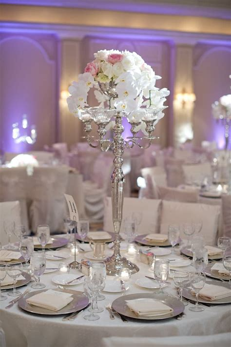 silver table decorations wedding at the houstonian with photos by adam
