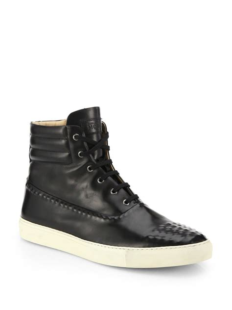 mcqueen studded leather high top sneakers in