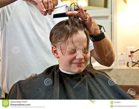 long haircuts for 9 year old boys boy getting haircut stock photos image 31908923