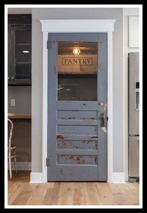 rustic serenity blue pantry door lauraashleykitchens