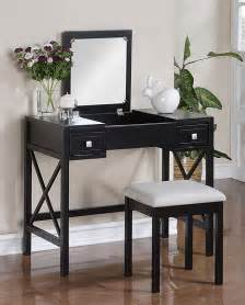 the black vanity table and bench