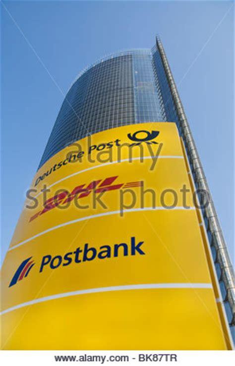 deutsche post bank sign with logos deutsche post and postbank stock photo