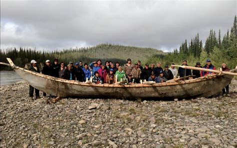 boat made of skins a large group of tulita community members youth and