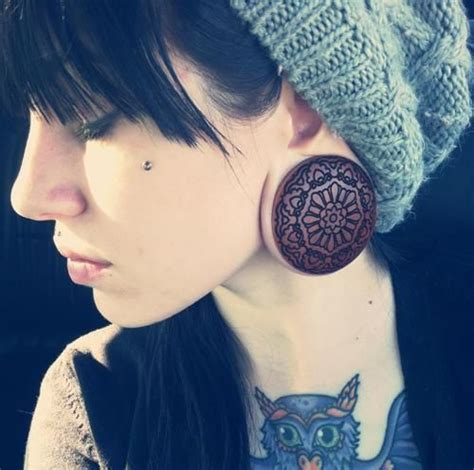 tattoo goo on stretched ears girls with plugs and tattoos tumblr google search
