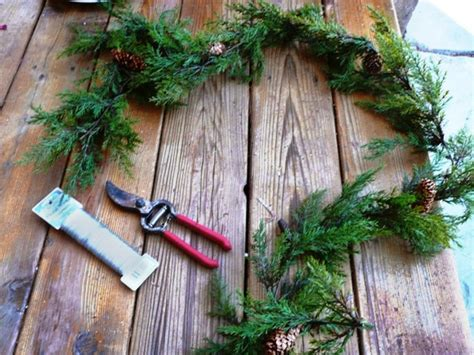 garland for decorating fences how to make a wreath from fence pieces and garland diy