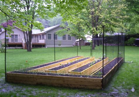 raised garden bed with fence how to win vs deer rabbits squirrels in the garden