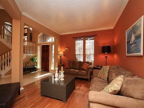 paint colors for small living room walls deep orange wall color with velvet beige sofa set for