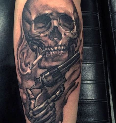 smoking skull with piston tattoo on calves for men