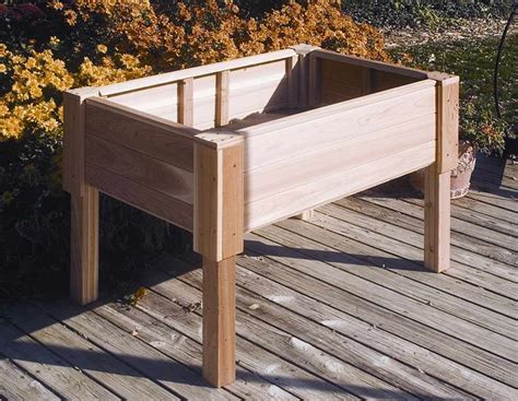 Raised Planter Boxes With Legs by Rectangular Raised 18 In D Cedar Garden Planter W Wooden Legs