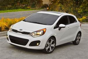 review the 2013 kia mixes utility with driving to