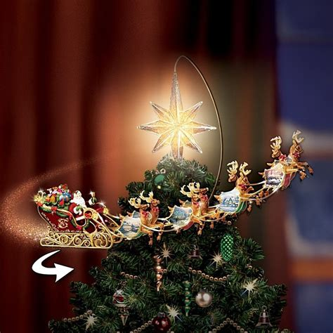 disney tree toppers for christmas trees disney tree topper animated motion rotating illuminated kinkade tree toppers