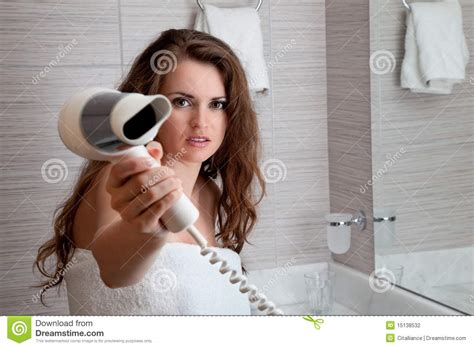 women in bathroom attractive woman using fen in bathroom stock photography