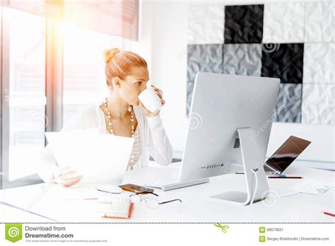 Office Worker At Desk Attractive Office Worker Sitting At Desk Stock Photo Image 69070631