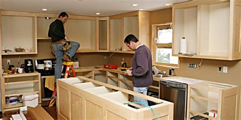 kitchen cabinet installer installing kitchen cabinets