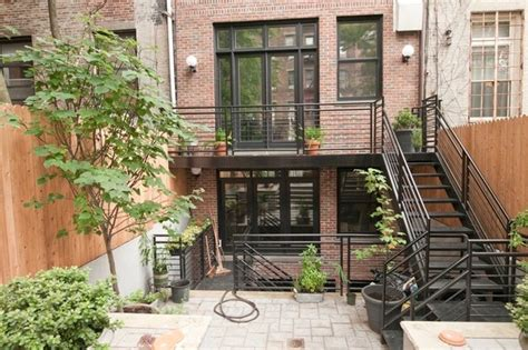 backyard nyc w 47th st manhattan brownstone renovation exterior