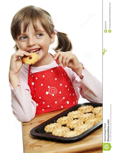 by littlecookiecom little girl eating cookies royalty free stock photos