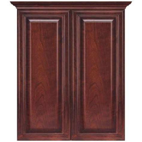 bathroom wall cabinets cherry masterbath raised panel 24 in w bath storage cabinet in