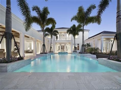 cool blue pool travertine deck royal palm trees