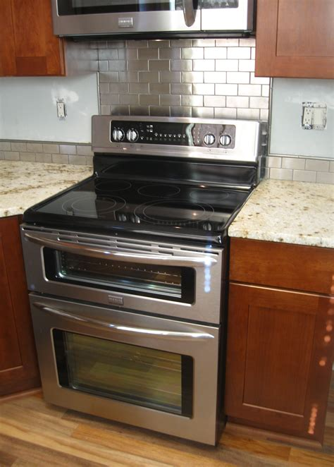 stainless steel backsplash stove randuwa kitchen renovation update granite and backsplash