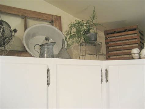 where to put things in kitchen cabinets decorating above the kitchen cabinets w antiques