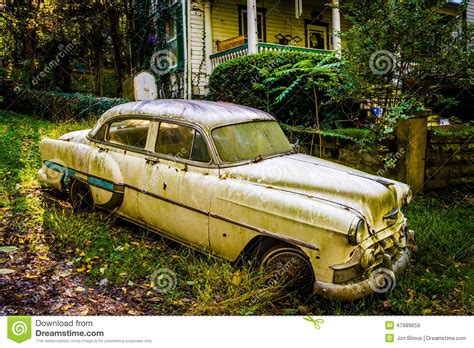 abandoned car in front of my house old car in front of a house in harpers ferry west virginia royalty free stock photo