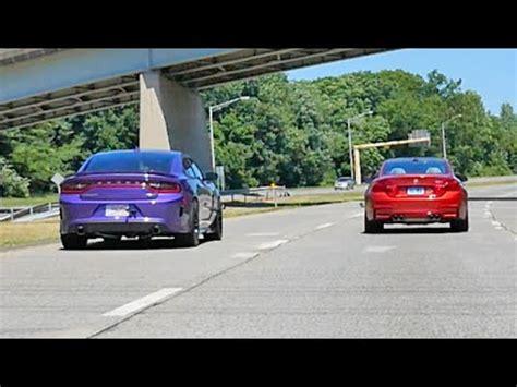 dodge m4 dodge charger hellcat vs bmw m4 rolling drag race