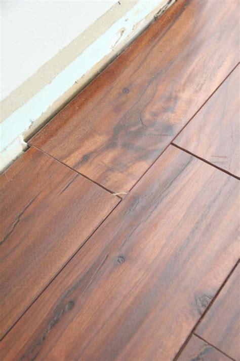 tips for laying laminate flooring bright green door