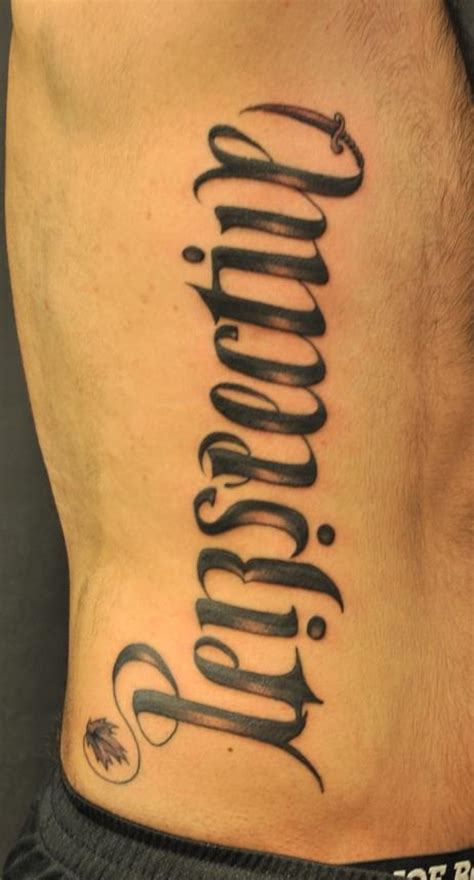 writing tattoos on ribs for men chronic ink tattoos toronto ribs ambigram by